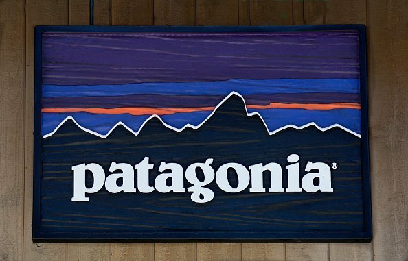 A sign hangs over the entrance to the Patagonia outdoor clothing shop in Vail, Colorado. The retail chain is based in Ventura, California | Photo: Getty Images