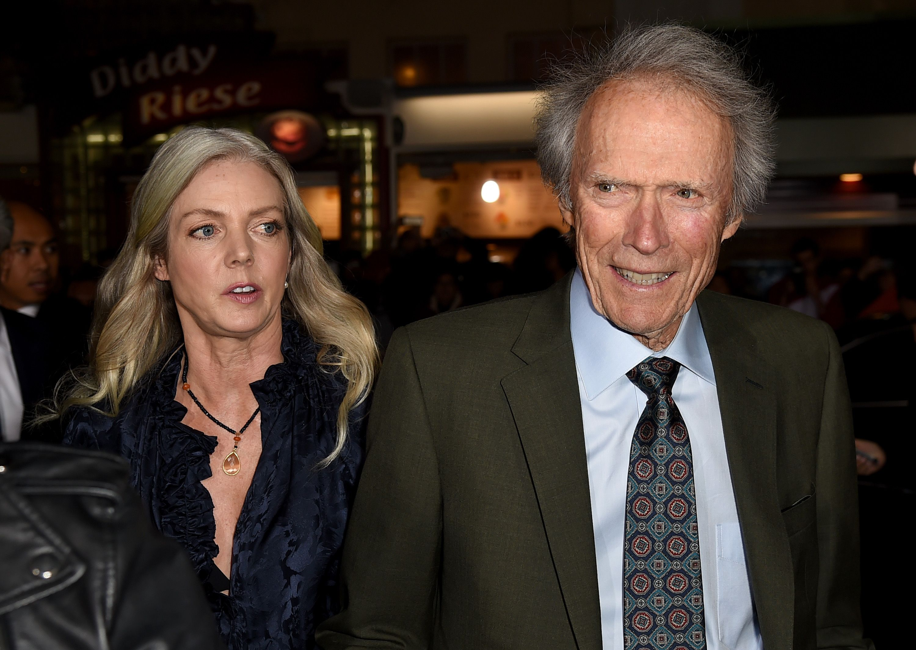 """Christina Sandera (L) and Clint Eastwood arrive at the premiere of Warner Bros. Pictures' """"The Mule"""" at the Village Theatre on December 10, 2018 