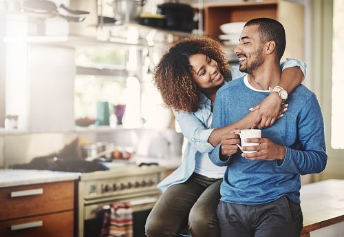 A happy couple relaxing in their home   Photo: Getty Images