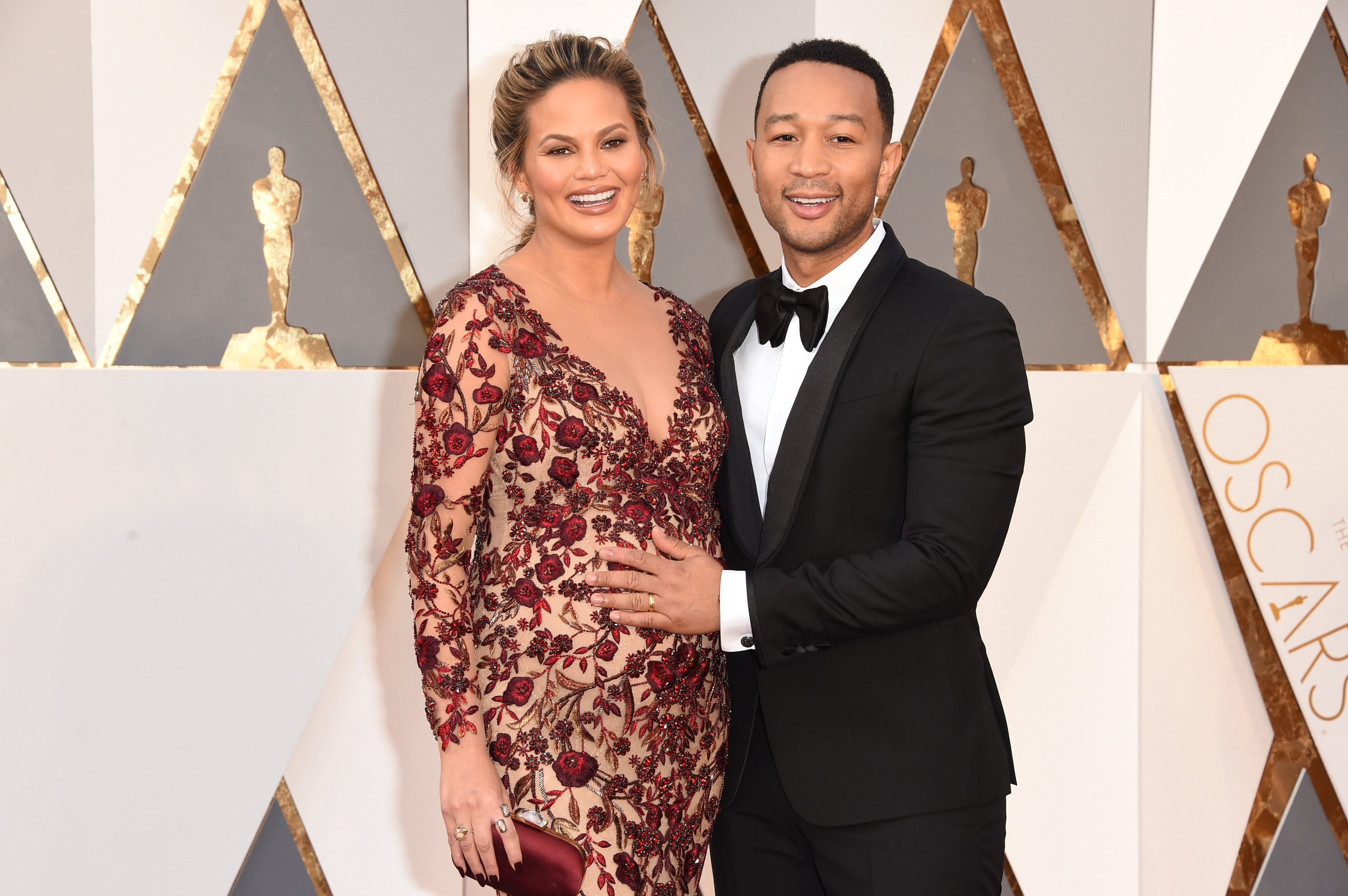 """Model Chrissy Teigen and """"Ordinary People"""" singer John Legend attend the 88th Academy Awards in 2016 in Hollywood City, California. 