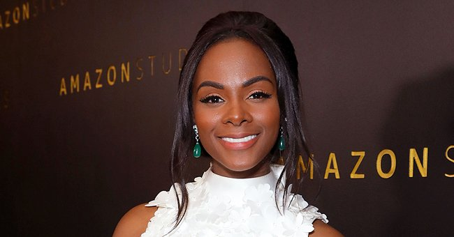 Sonic the Hedgehog's Tika Sumpter Flashes Her Smile Posing in a Red Top In New Selfie