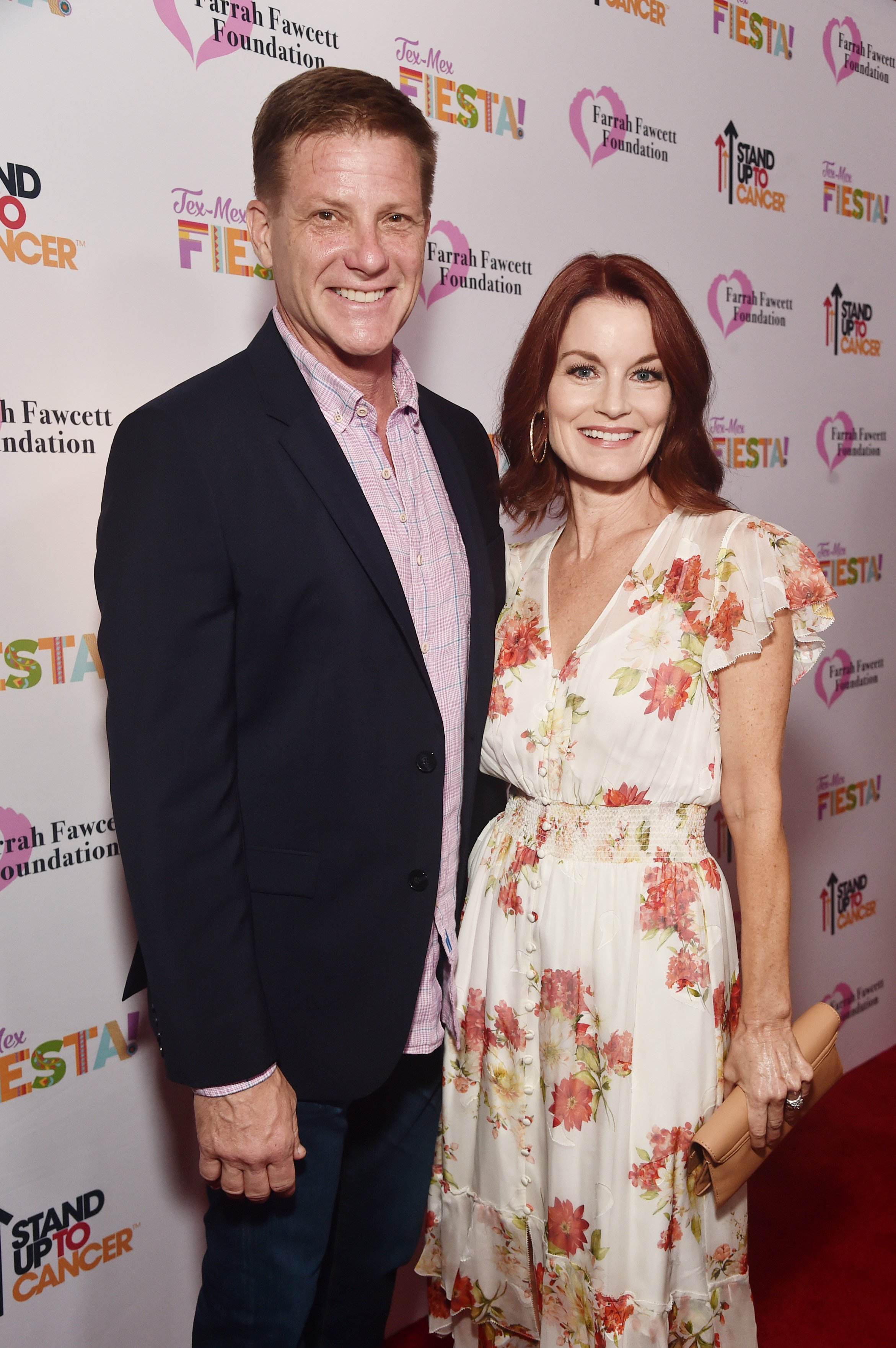 Doug Savant (L) and Laura Leighton attend the Farrah Fawcett Foundation's Tex-Mex Fiesta on September 06, 2019, in Los Angeles, California. | Source: Getty Images.