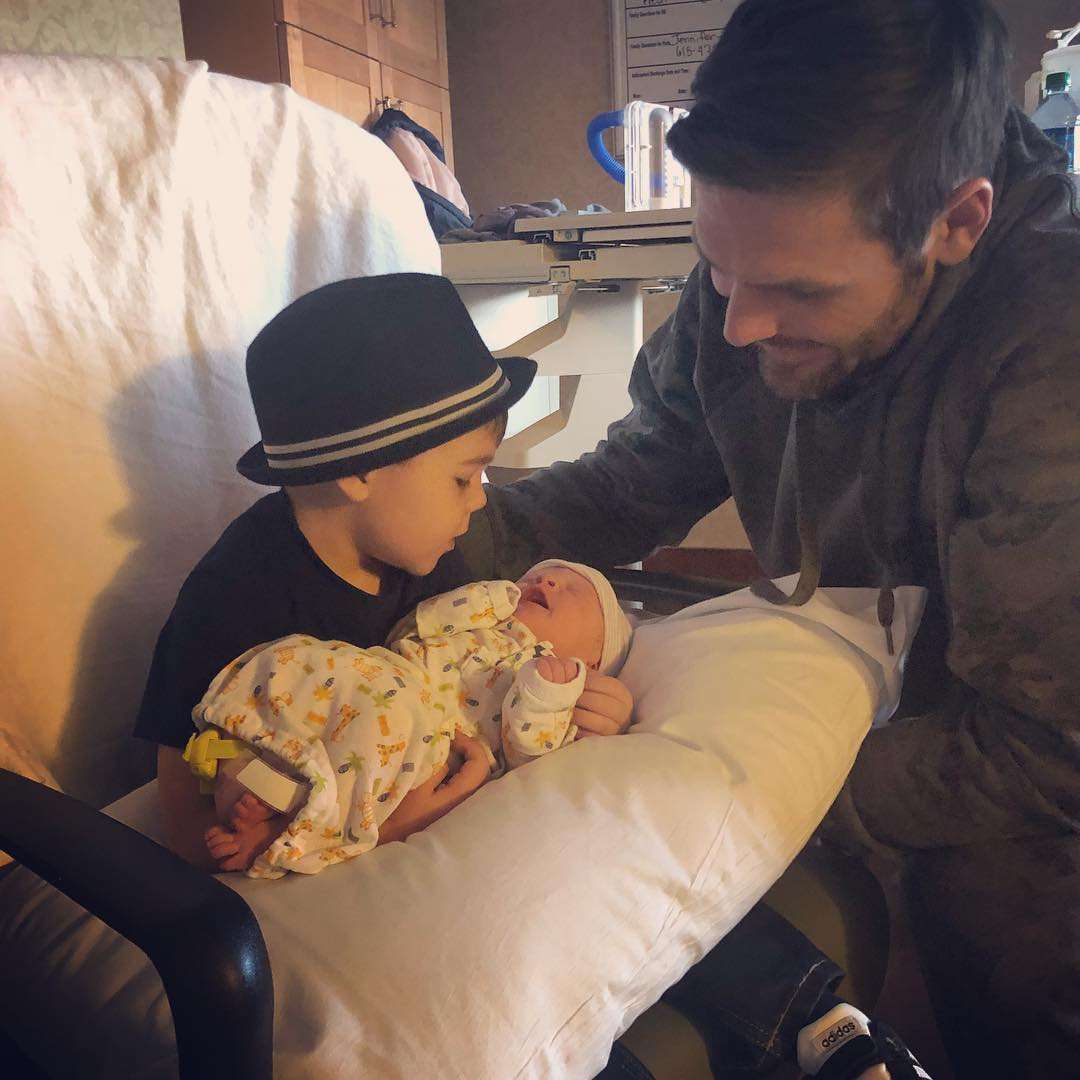 Isaiah, 3, meets his baby brother. Photo credit: Instagram/@carrieunderwood
