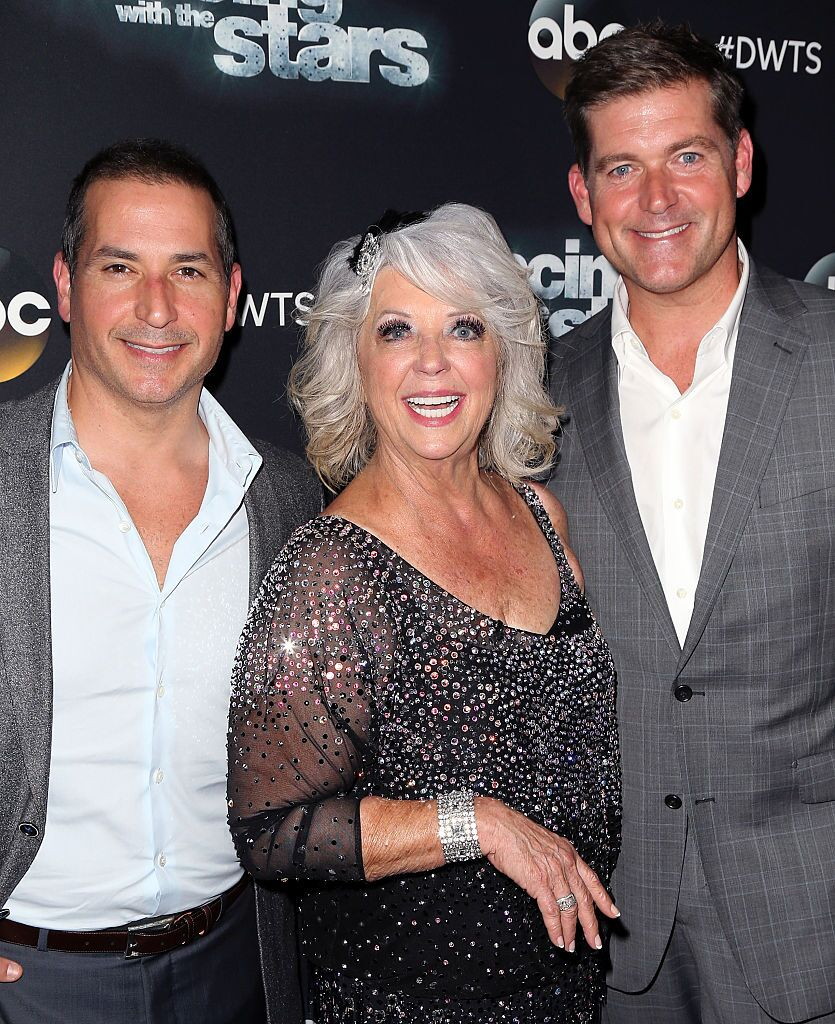 Celebrity chef/TV personality Paula Deen (C) poses with sons cook/TV personality Bobby Deen (L) and cook/TV personalitJamie Deen at 'Dancing with the Stars' Season 21  | Photo: Getty Images