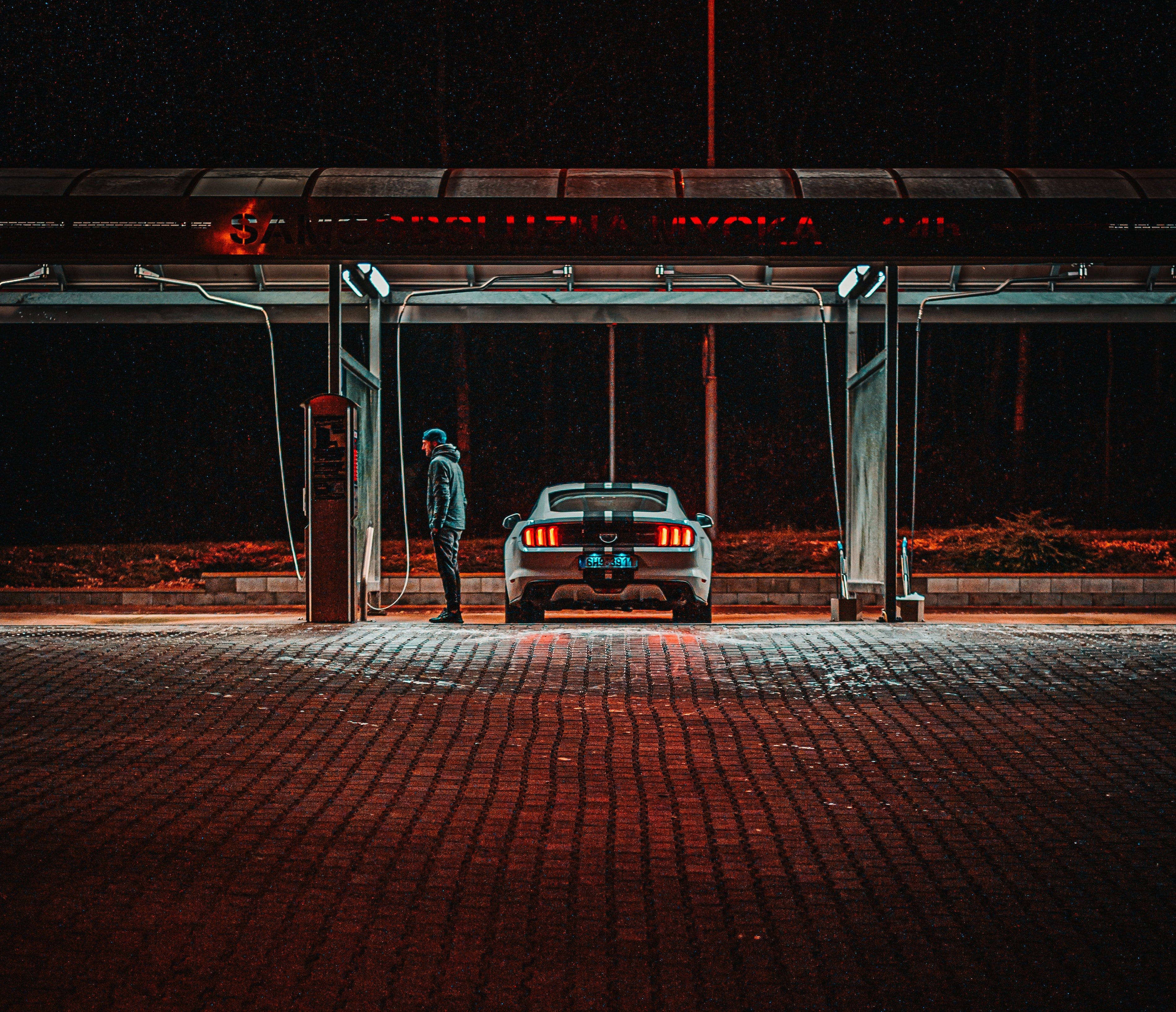 A man fills up his car with gas at a station | Photo: Pexels/Jan Kopřiva