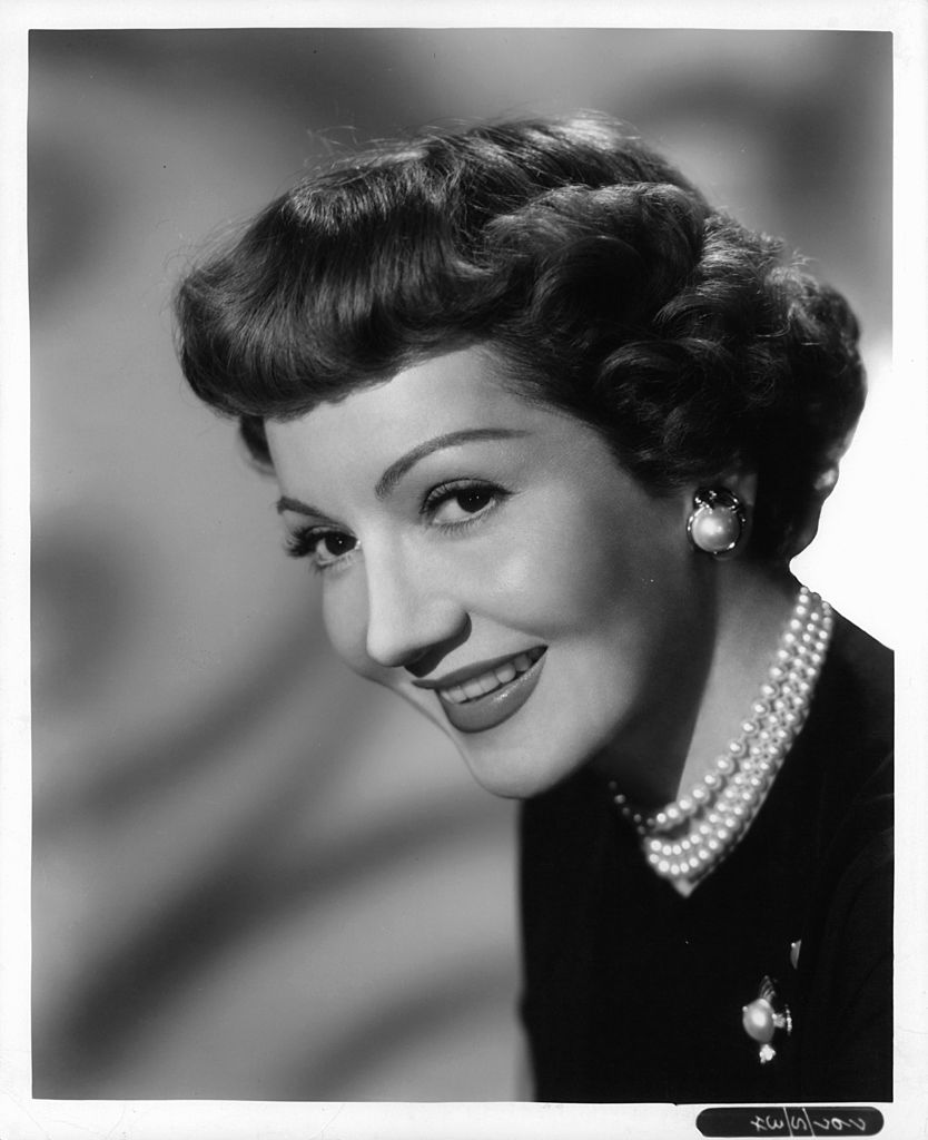 """Claudette Colbert's publicity portrait for the film """"Outpost In Malaya,"""" circa 1952 