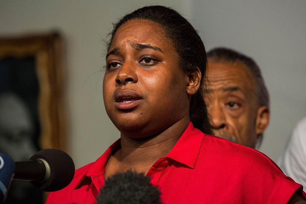 Erica Garner, Eric Garner's daughter, attends a press conference held with her familiy members and the Reverand Al Sharpton calling for further justice and legal action against the police officers responsible in the death of Eric Garner | Photo: Getty Images