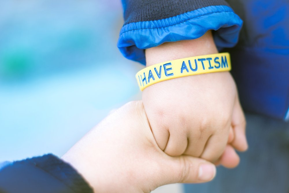Mom holding hand her autistic child | Source: Shutterstock