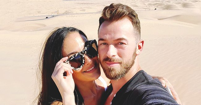 Fans React to Artem Chigvintsev Sweetly Cradling Nikki Bella's Huge Baby Bump