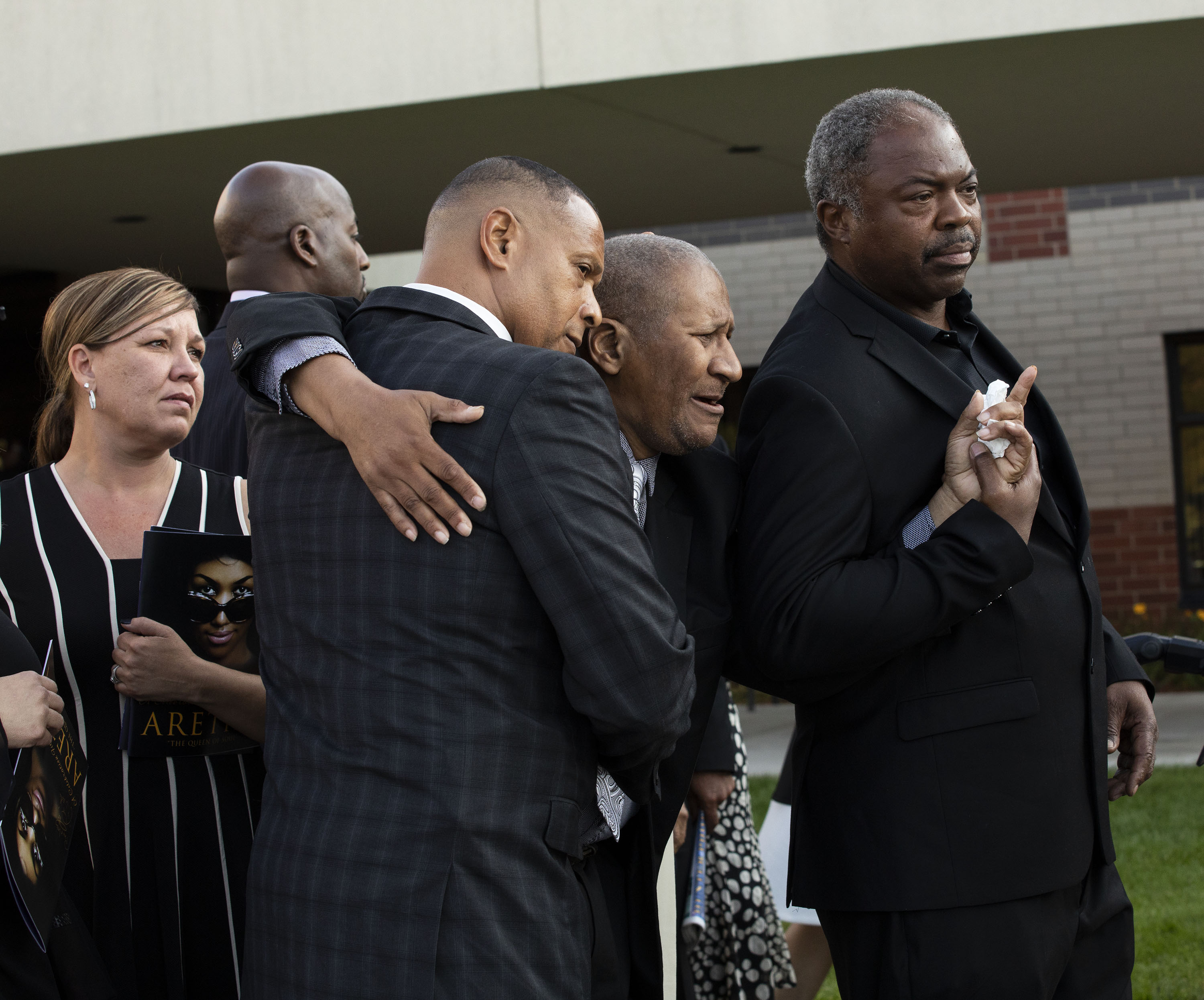Aretha Franklin's eldest son, Clarence Franklin, pictured at the center of two men mourns the death of his mother outside Greater Grace Temple following her funeral on August 31, 2018 in Detroit, Michigan.   Source: Getty Images