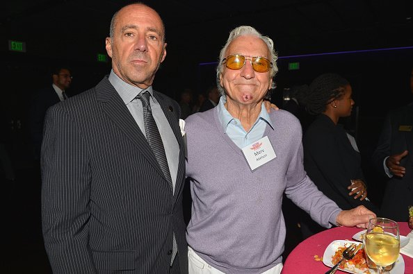 Bob Beitcher and Merv Adelson attend the Unsung Heroe Awards at Club Nokia on October 9, 2013, in Los Angeles, California. | Source: Getty Images.