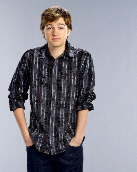 """Angus T. Jones poses for his show """"Two and a Half Men"""" in 2003 