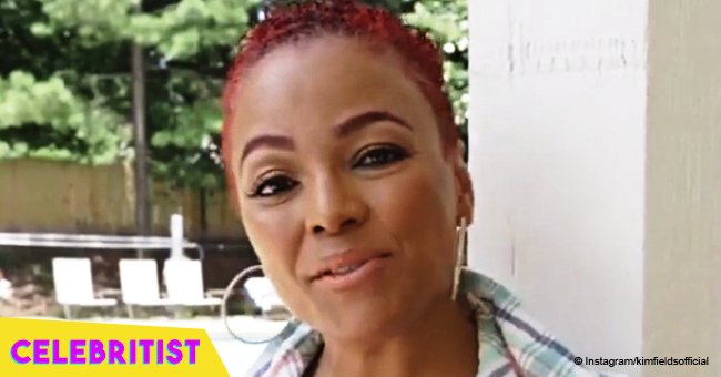Kim Fields, 49, turns heads in black & white checked romper, showing off her red mohawk hairstyle