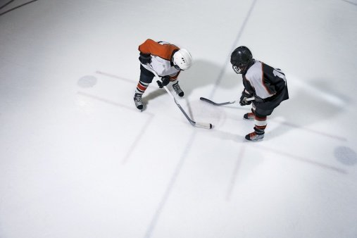 Youth hockey players face off | Photo: Getty Images