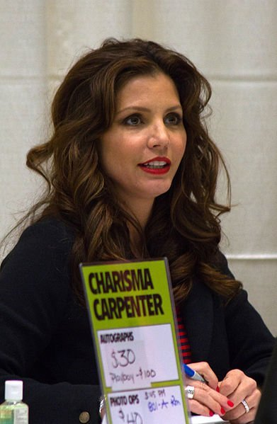 Charisma Carpenter signs autographs at the Toronto Comicon.   Source: Wikimedia Commons