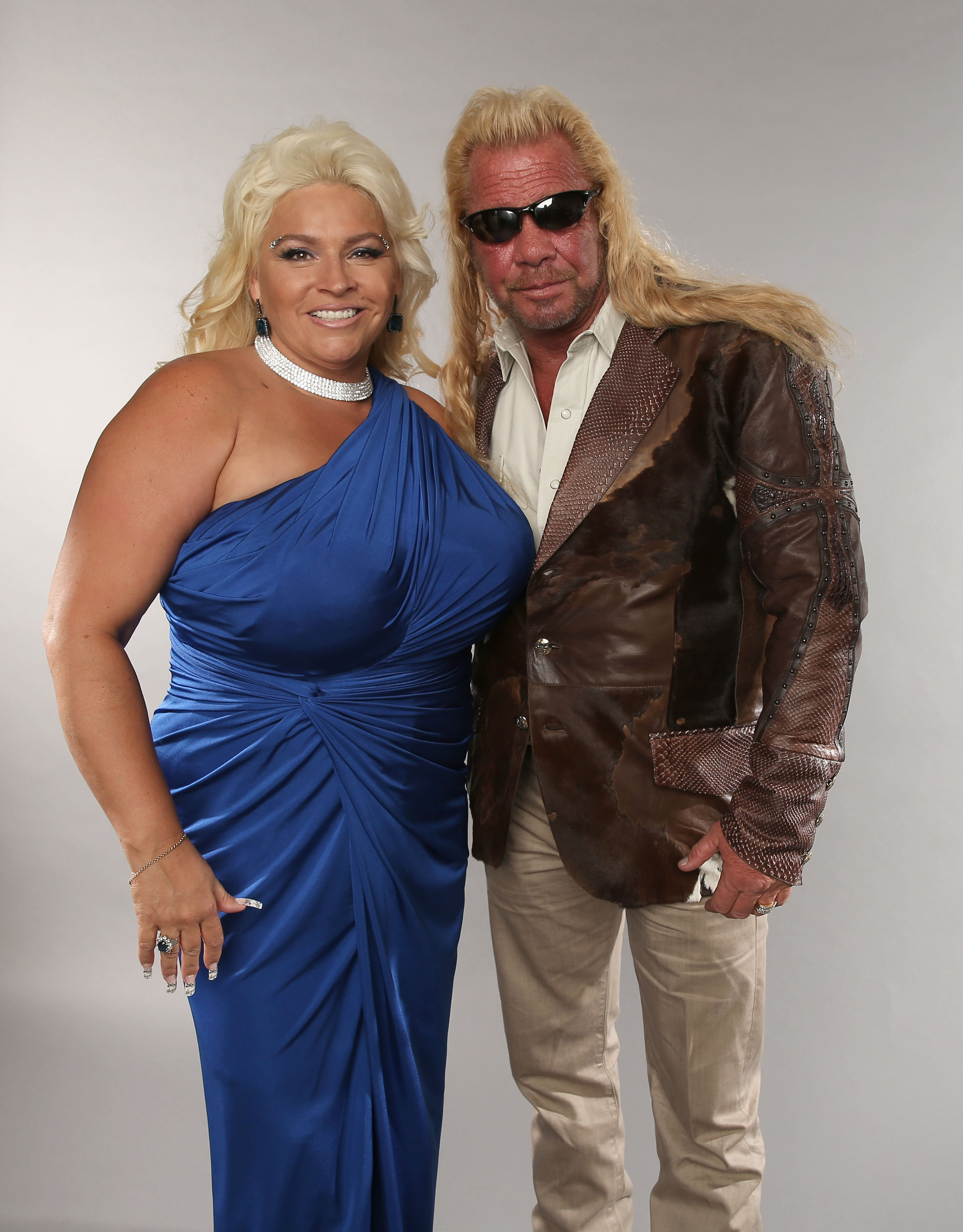 Duane Dog Lee Chapman and Beth Chapman pose at the Wonderwall portrait studio during the 2013 CMT Music Awards. | Source: Getty Images