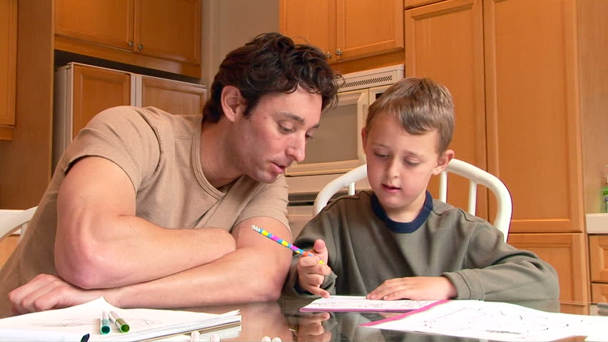 Father helping son with homework | Photo: Shutterstock.com