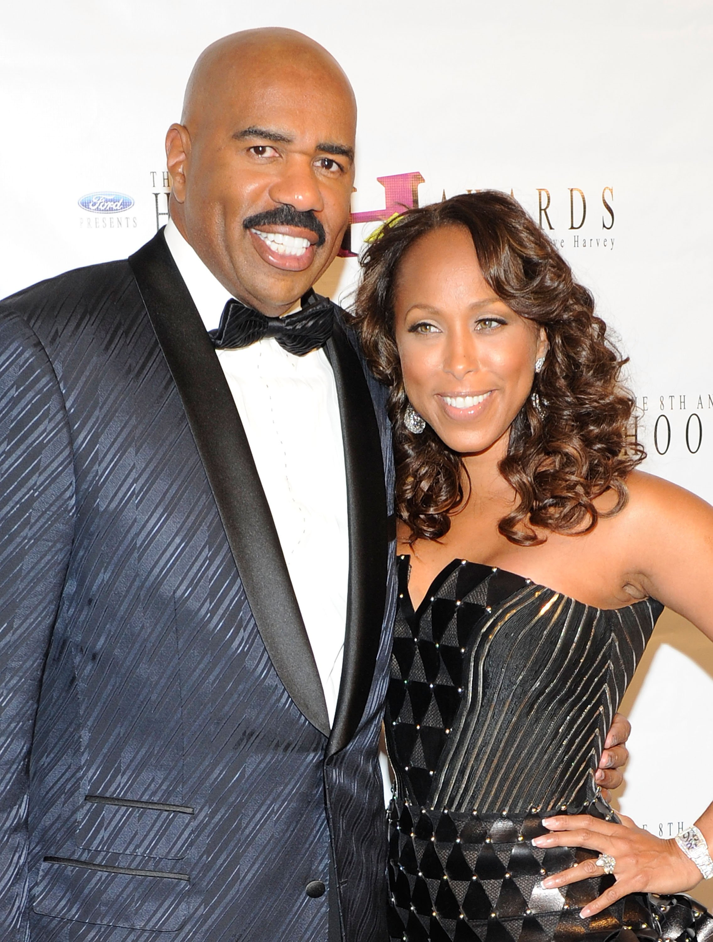Actor/comedian Steve Harvey (L) and his wife Marjorie Harvey arrive at the eighth annual Ford Hoodie Awards at the Mandalay Bay Events Center August 28, 2010 |Photo: Getty Images
