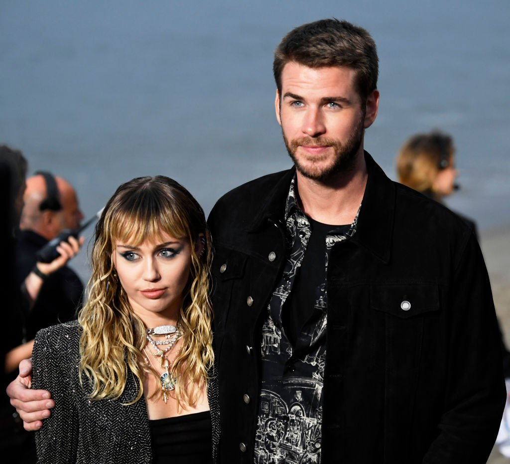 Miley Cyrus and Liam Hemsworth attend the Saint Laurent Mens Spring Summer 20 Show. | Photo: Getty Images