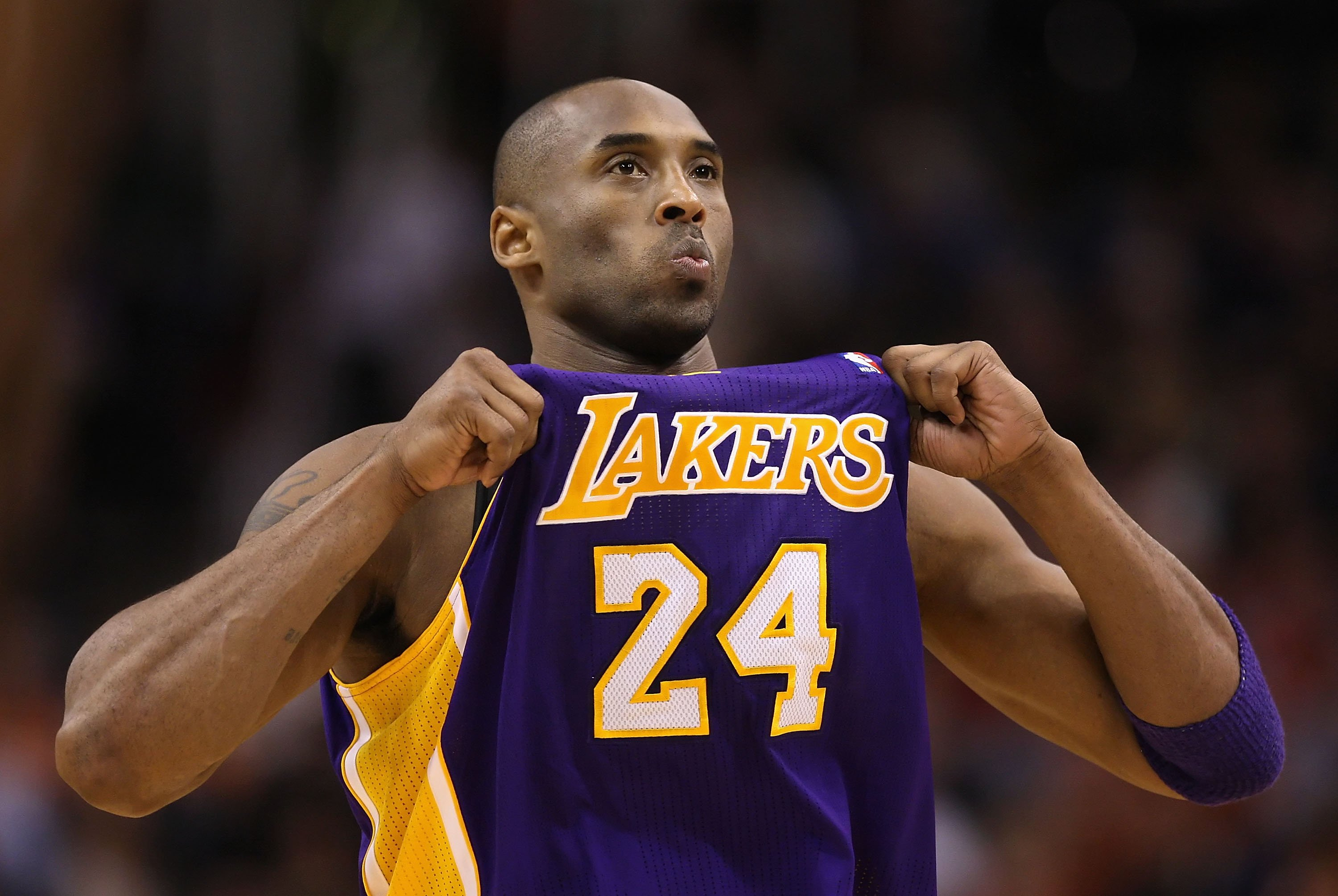 Kobe Bryant #24 of the Los Angeles Lakers adjusts his jersey during the NBA game against the Phoenix Suns at US Airways Center on February 19, 2012   Photo: GettyImages