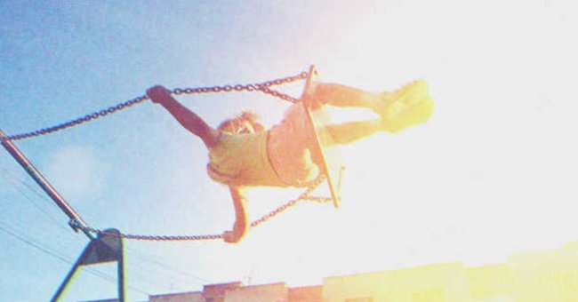 Girl playing on a swing | Source: Shutterstock