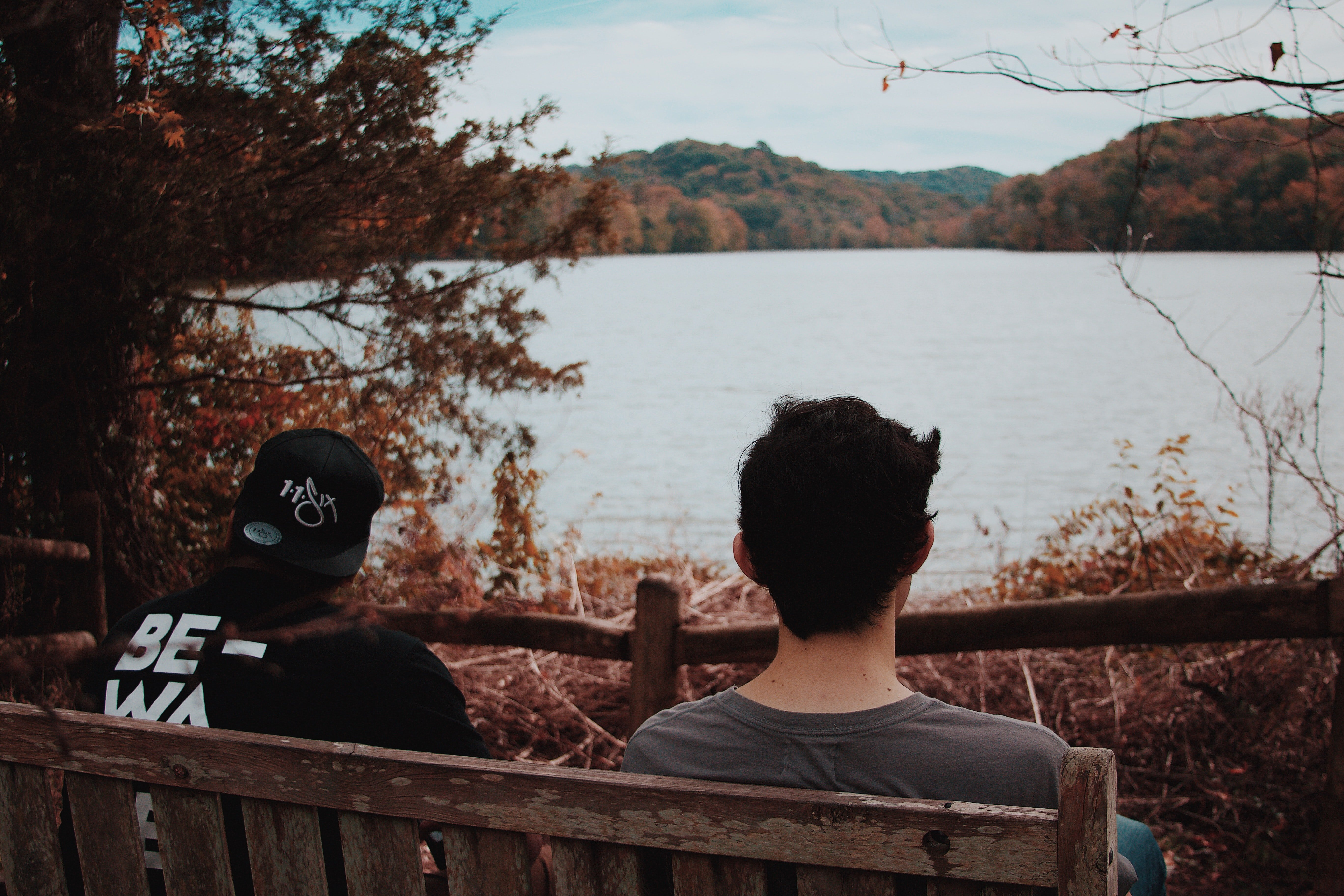 Two men watch a beautiful landscape while recalling their past | Photo: Unsplash