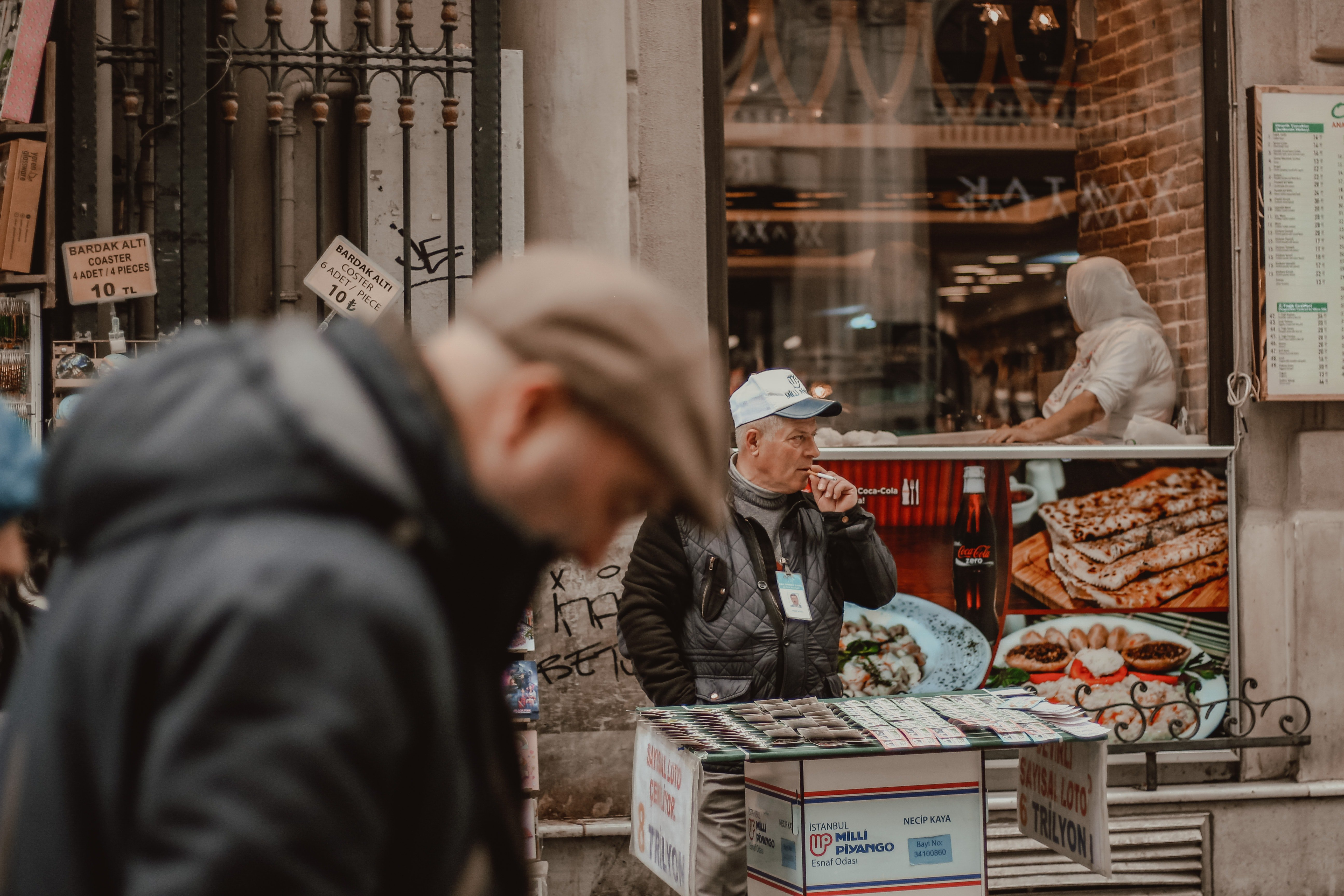 An image of an elderly delivery man in front of a stall   Photo: Pexels