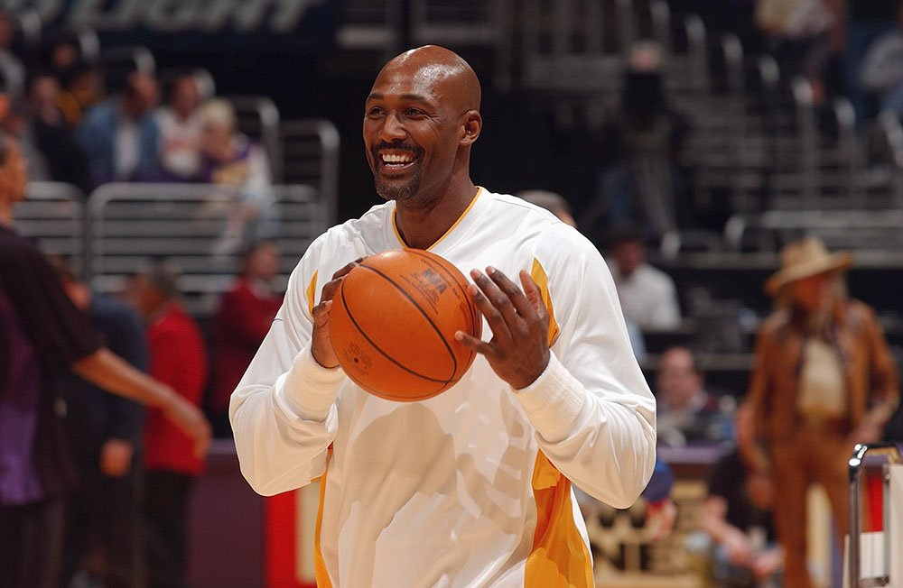 Karl Malone #11 of the Los Angeles Lakers smiles during the game against the Utah Jazz at Staples Center on March 28, 2004 in Los Angeles, California. I Image: Getty Images.