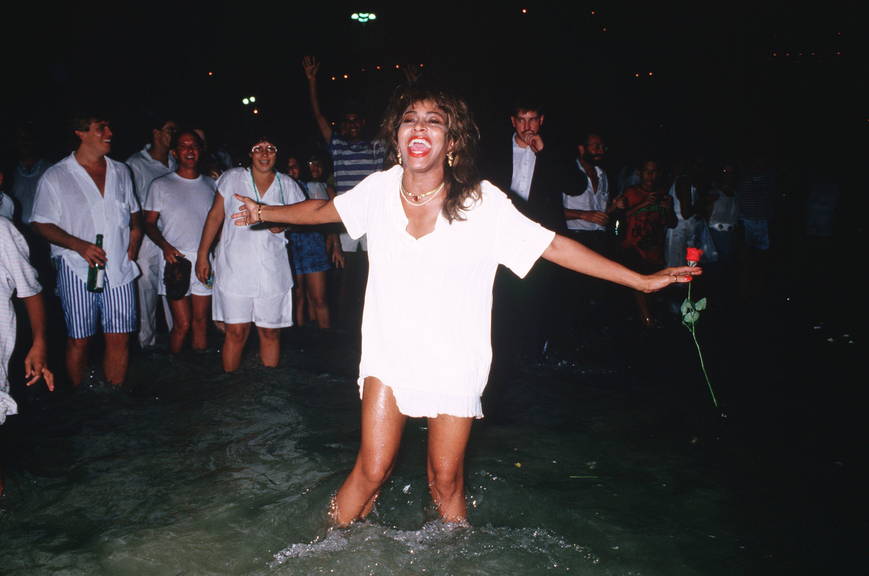 Tina Turner in the sea on New Years Eve in Rio de Janeiro, Brazil in 1988 | Source: Getty Images