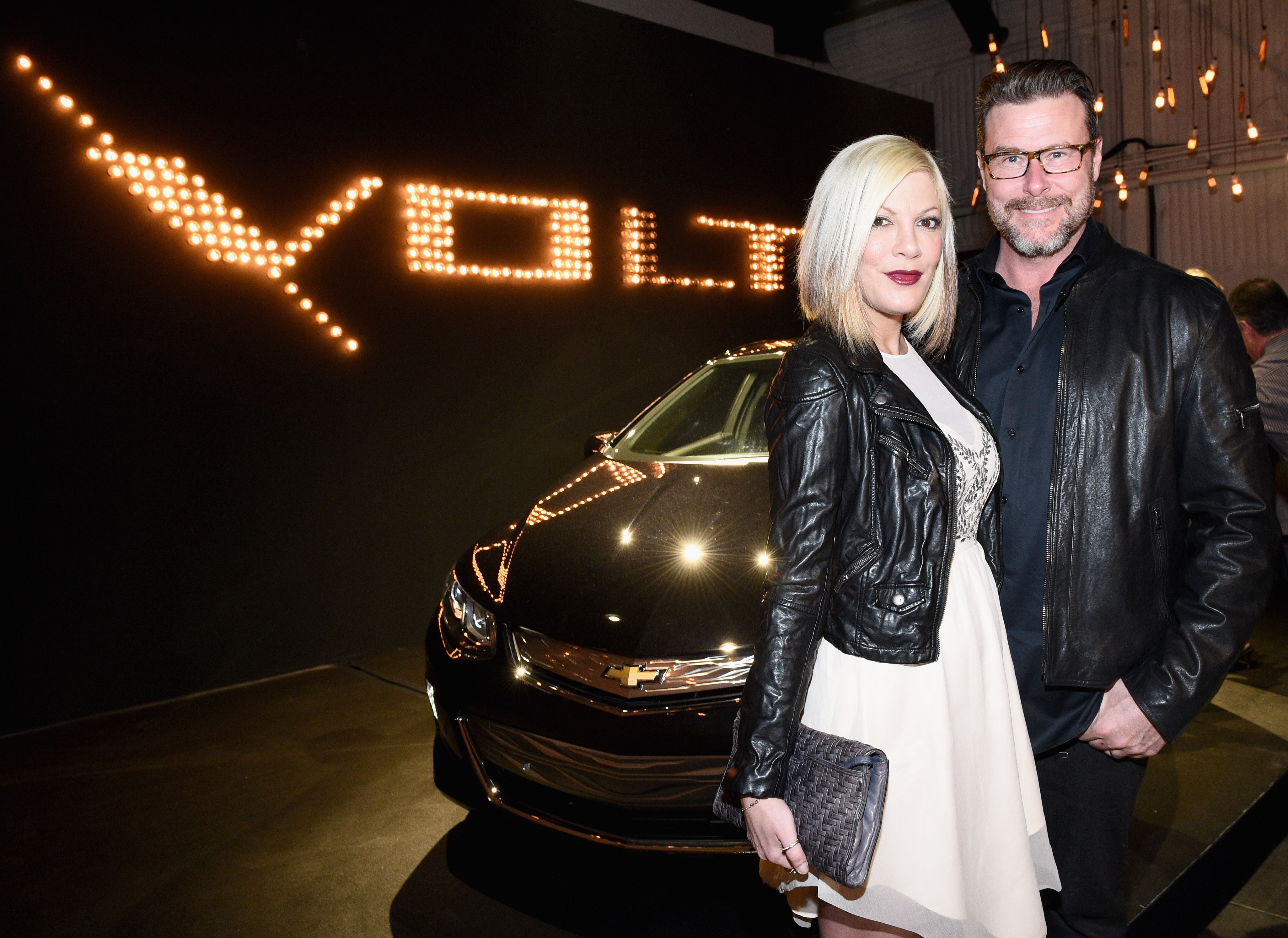 Tori Spelling (L) and Dean McDermott attend West Coast Reveal Of The New 2016 Next Generation Chevrolet Volt at Quixote Studios on January 12, 2015, in Los Angeles, California. | Source: Getty Images.