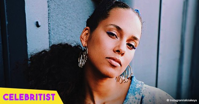 Alicia Keys shows off youthful look in white shirt & tight purple pants in recent pic
