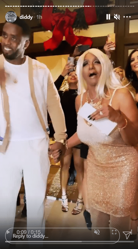 """Rap mogul Sean """"Diddy"""" Combs surprises his mom Janice with a $1-million check during her birthday party in Los Angeles.  