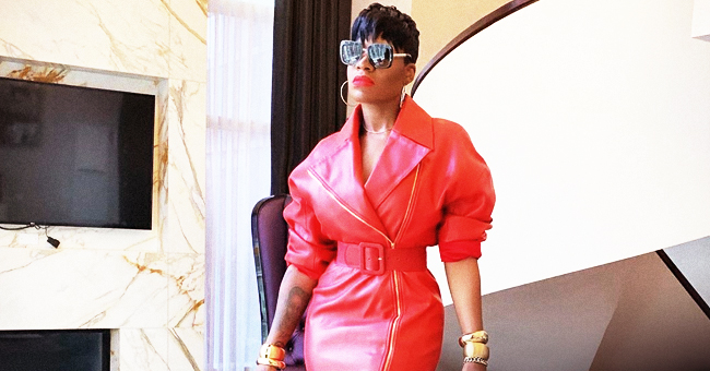 Here's Fantasia as a Sultry 'Little Red Riding Hood' in Belted Mini Dress & Boots