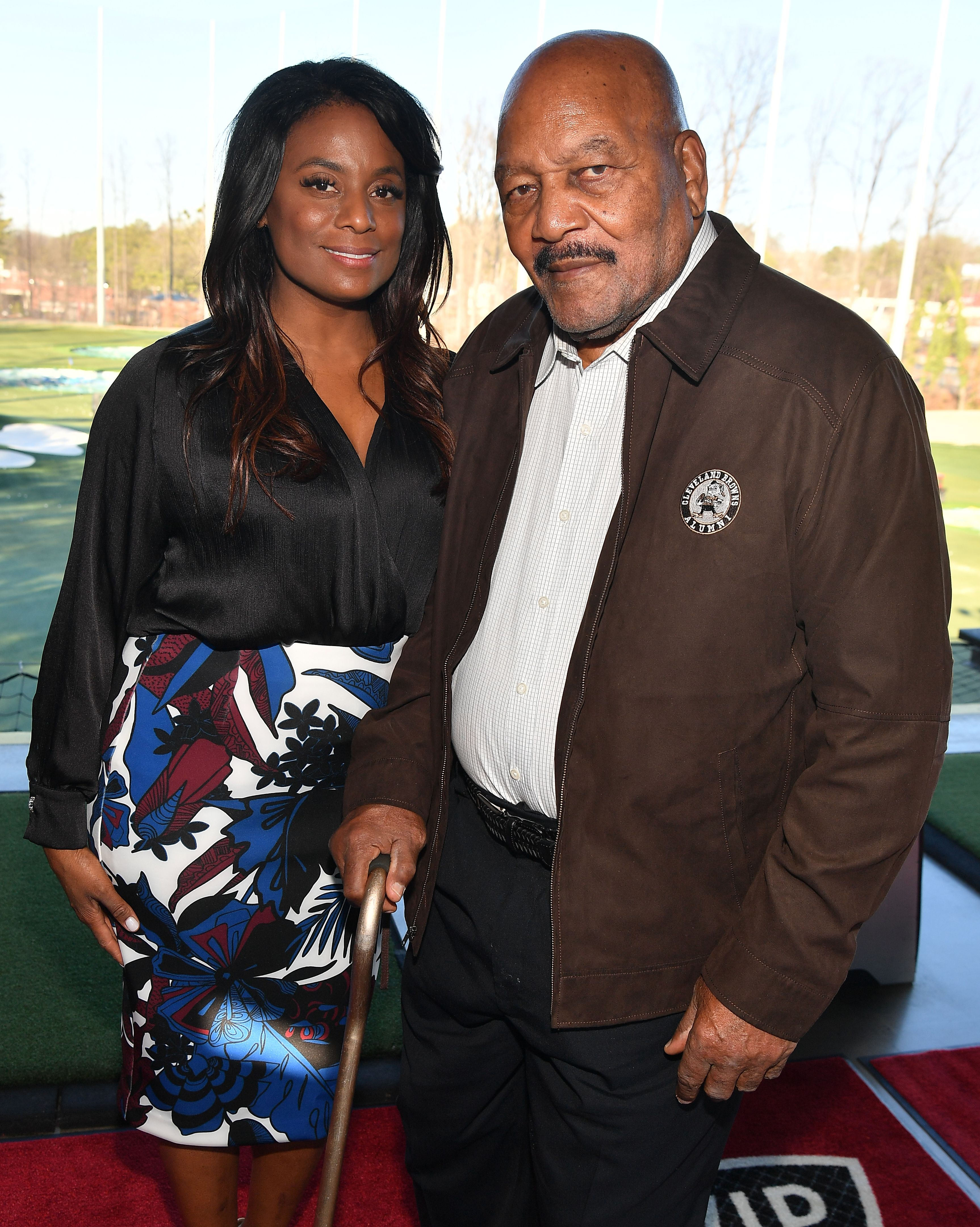 Jim Brown and his wife Monique Brown attend Jim Brown Legends of Football Golf Tournament at Topgolf Midtown on February 01, 2019 in Atlanta, Georgia | Source: Getty Images
