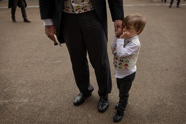 A boy and his dad wearing matching waistcoats    Photo: Getty Images