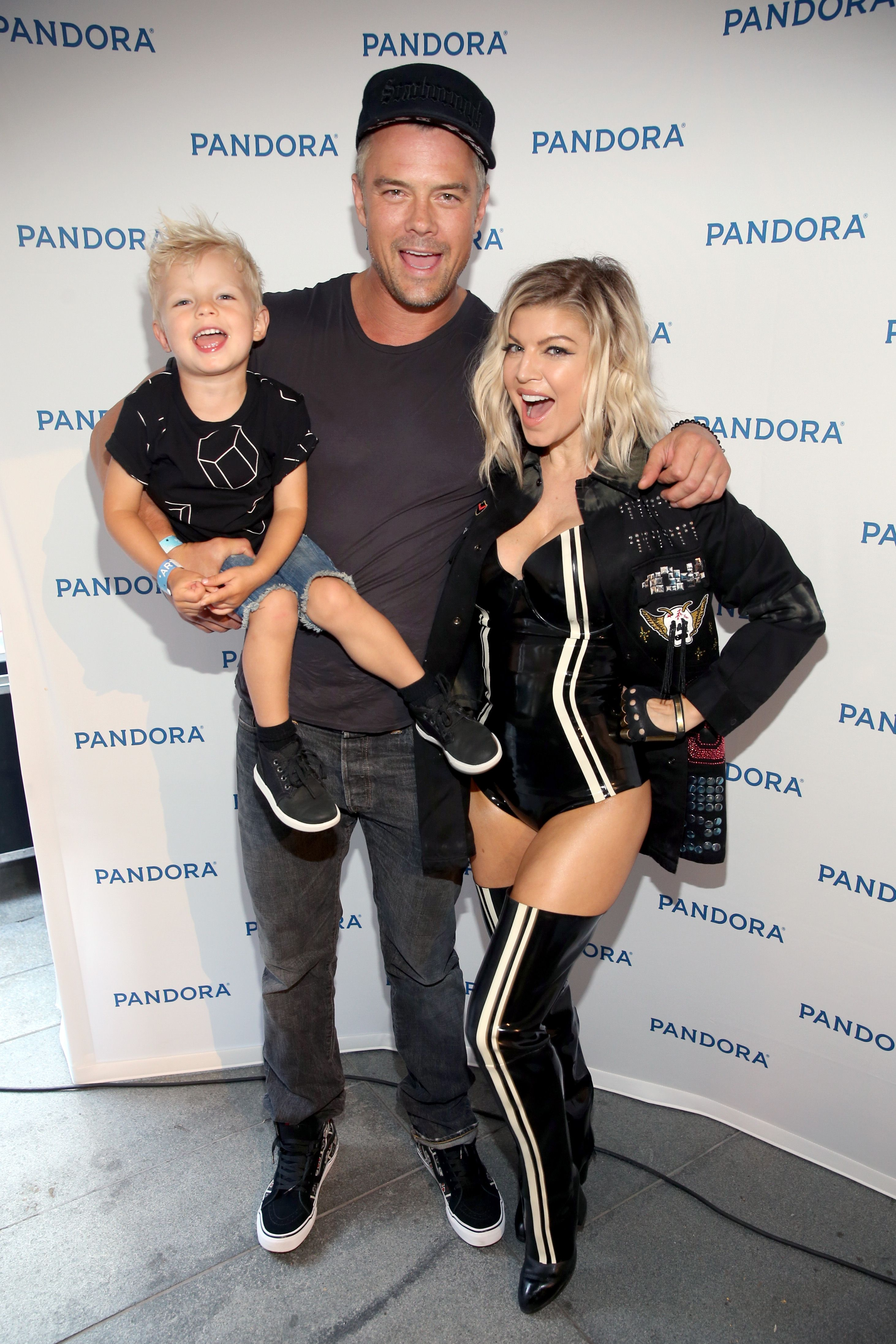 Josh Duhamel, and Fergie with son Axl at Pandora Summer Crush in 2016 in Los Angeles, California | Source: Getty Images