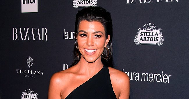 Kourtney Kardashian's Son Reign Displays Festive Colors in Adorable Photos near Christmas Trees