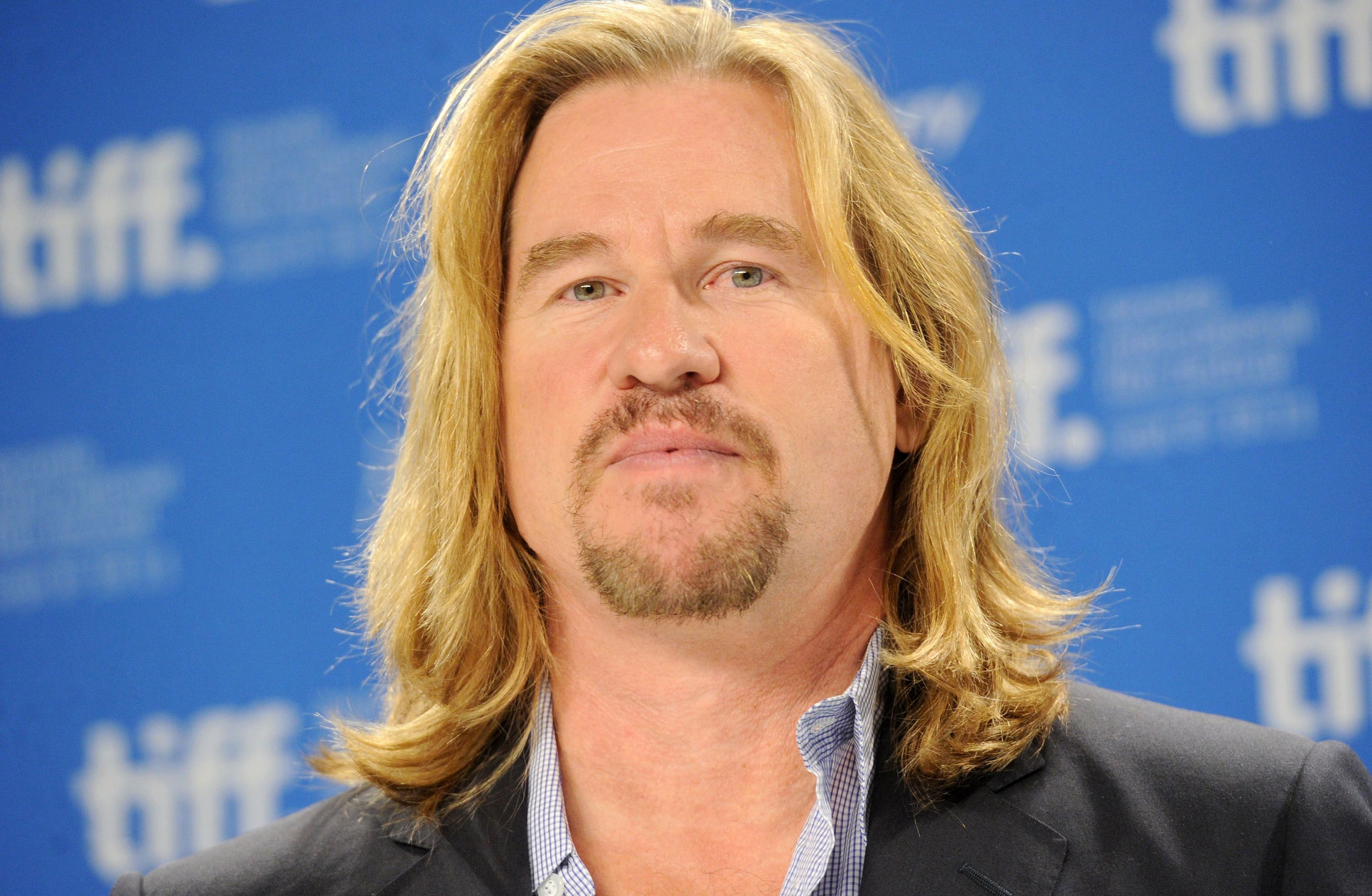 "Actor Val Kilmer speaks onstage at the ""Twixt"" press conference during the 2011 Toronto International Film Festival. 