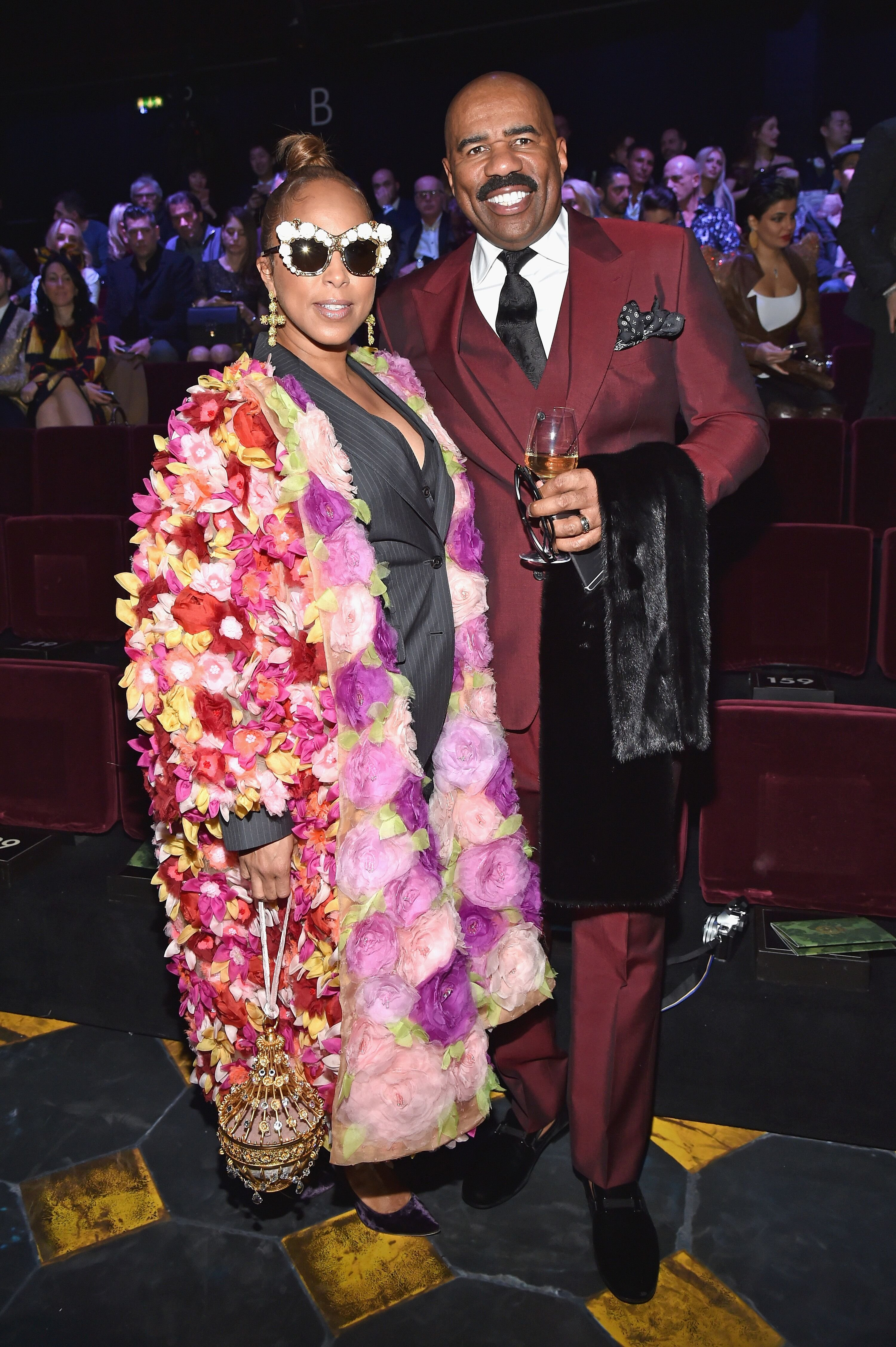 Marjorie Bridges-Woods and Steve Harvey attend the Dolce & Gabbana show during Milan Men's Fashion Week Fall/Winter 2017/18 on January 14, 2017 in Milan, Italy. | Source: Getty Images