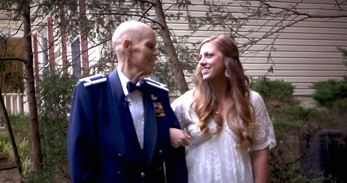 Becky Carey shares a priceless moment with her father, Timothy Carey during a photo shoot months before her wedding. | Source: YouTube/InsideEdition