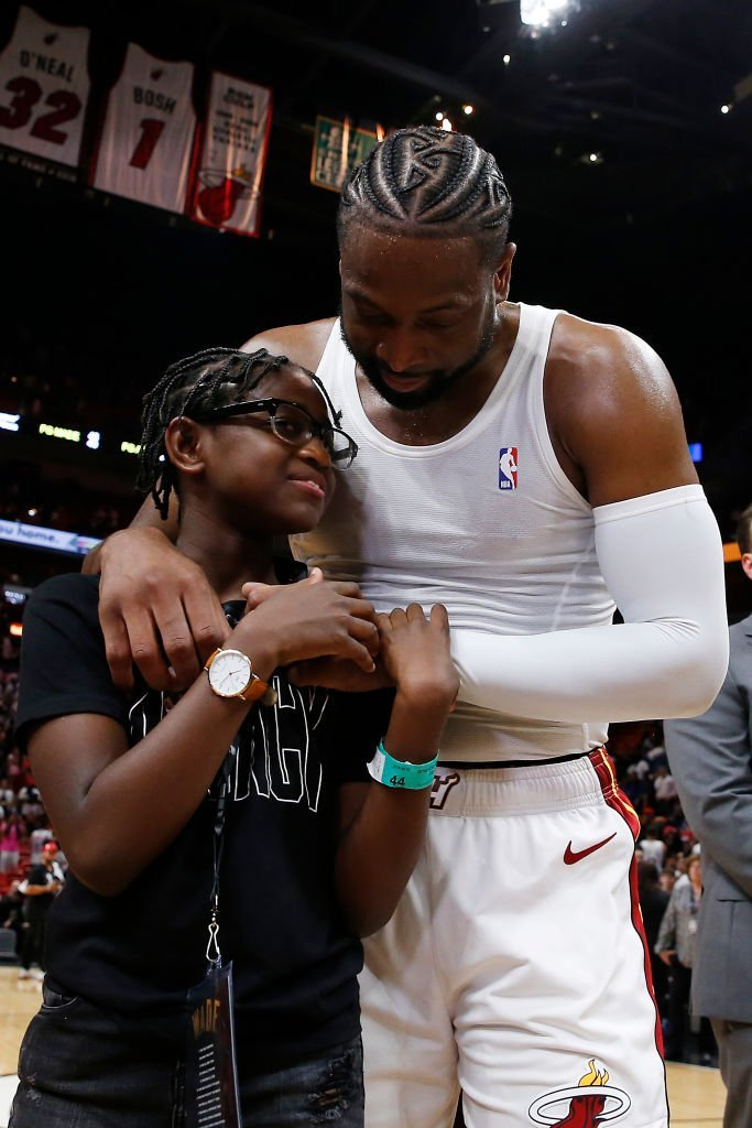 Dwyane Wade hugs his daughter, Zaya Wade, after his final home game at American Airlines Arena on April 09, 2019, in Miami, Florida | Photo: Getty Images