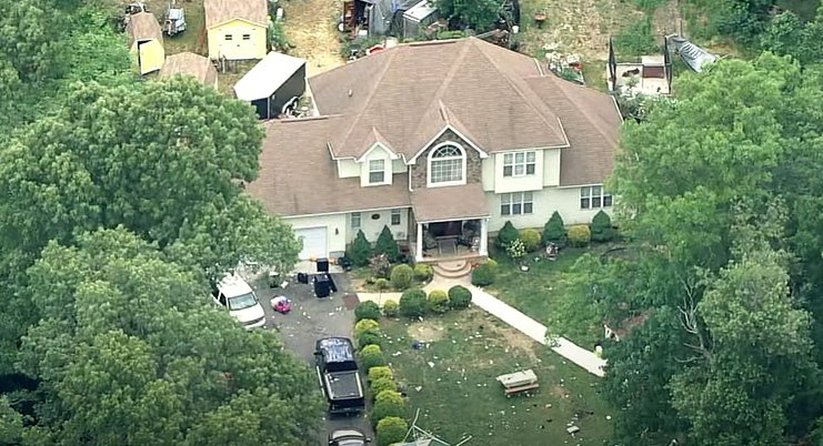 Debris can be seen scattered around the property in Fairfield Township, New Jersey, where the birthday party was taking place | Photo: Youtube/6abc Philadelphia