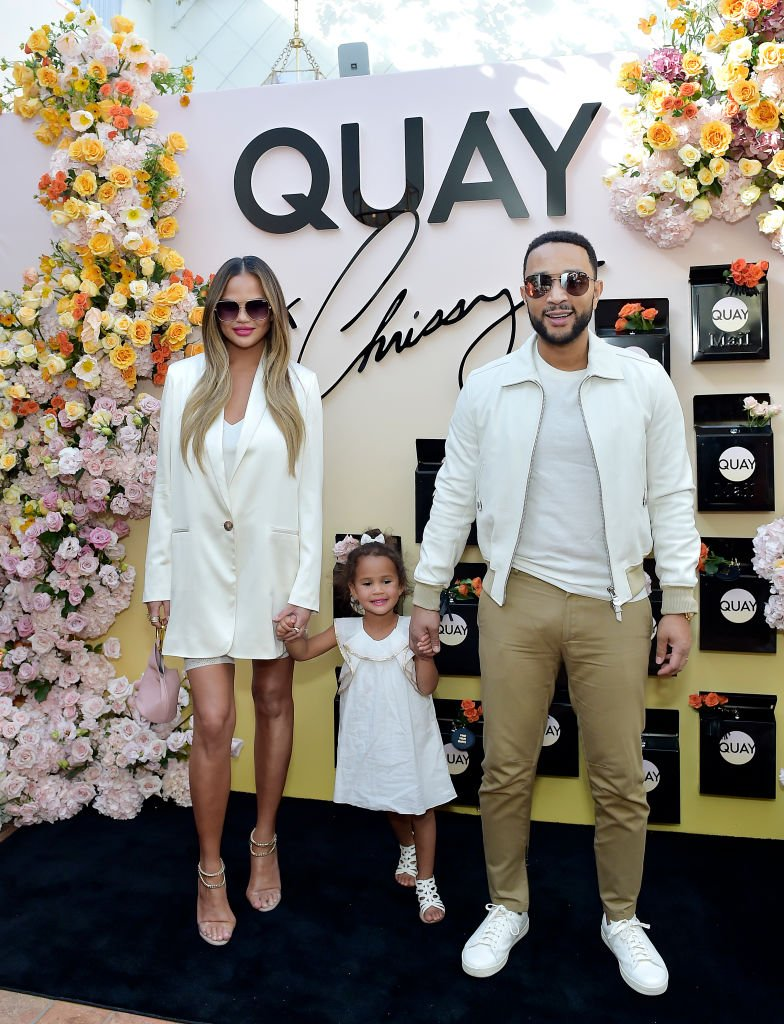Chrissy Teigen and daughter Luna and John Legend attend QUAYXCHRISSY Launch Party at Olivetta| Photo: Getty Images
