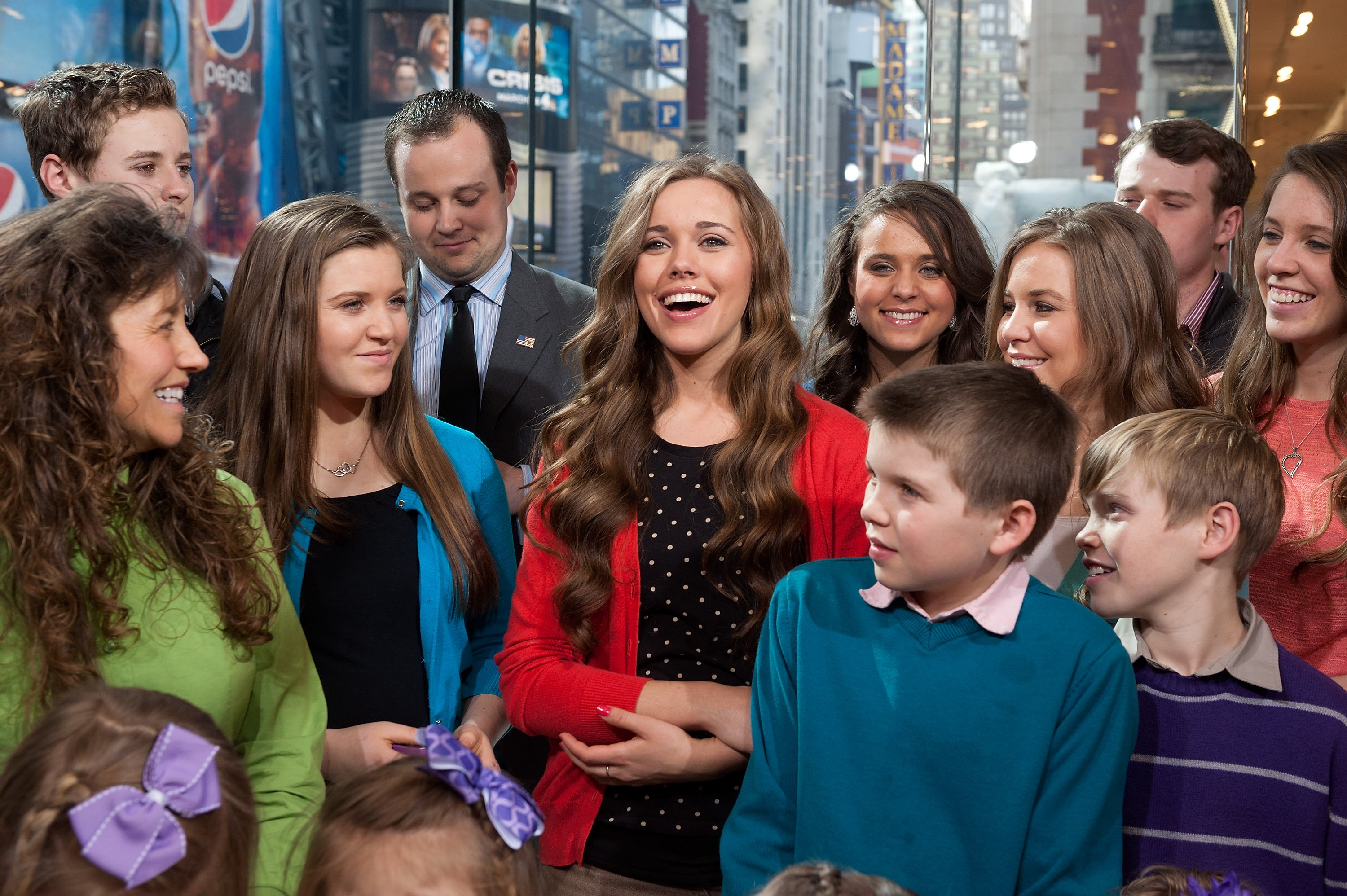 """The Duggar family visits """"Extra"""" at their New York studios at H&M in Times Square on March 11, 2014 in New York City 