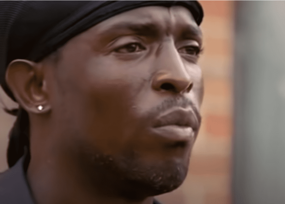 A photo of Michael K. Williams acting as Omar Little from a scene from The Wire | Photo: Youtube/ chokurei51