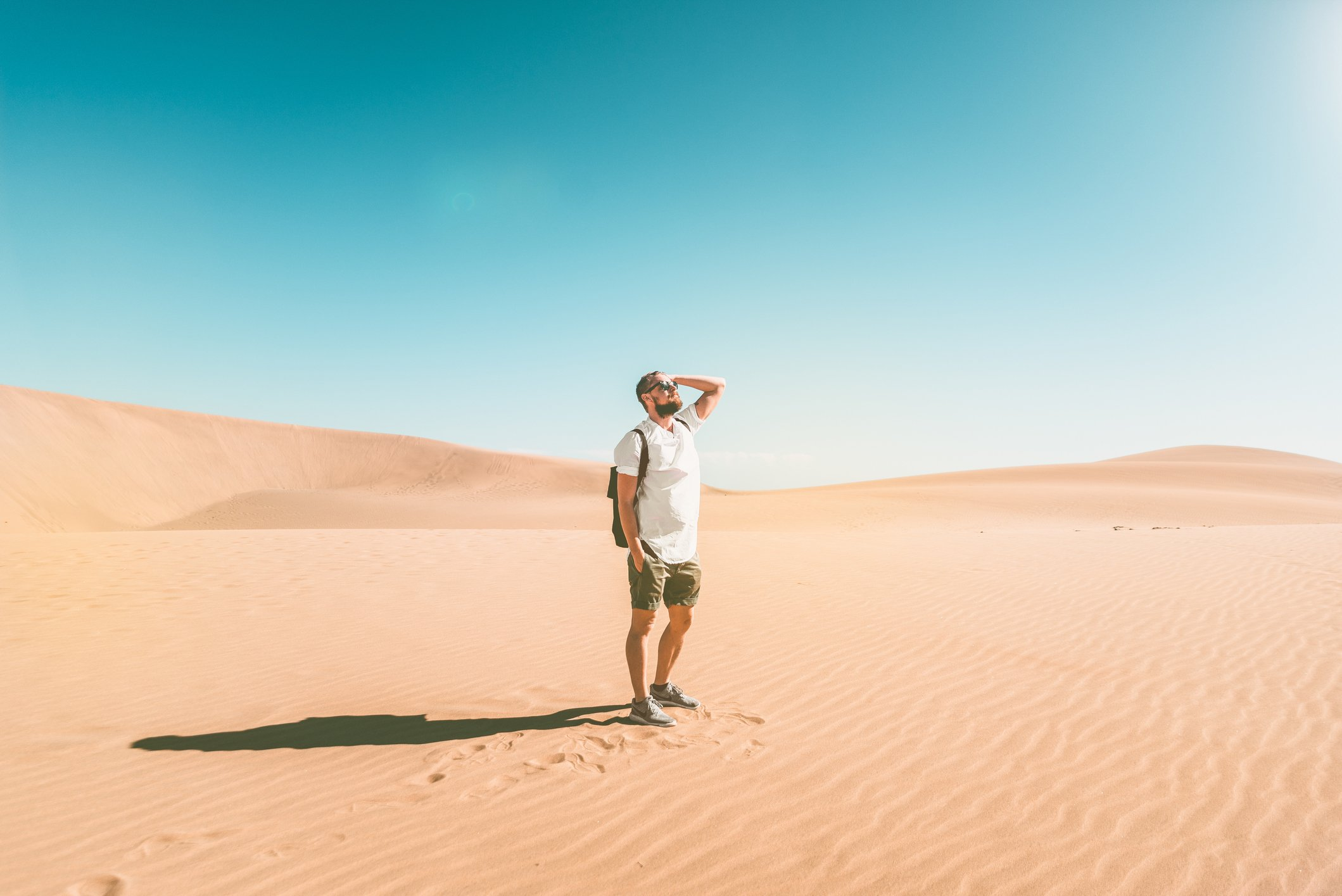 Full Length Of Young Man Standing In Desert Against Clear Sky   Photo: Getty Images