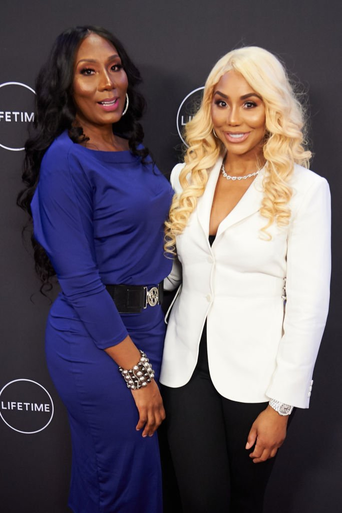 """Towanda Braxton and Tamar Braxton pose for a photo during the premiere of """"Faith Under Fire: The Antoinette Tuff Story"""" at the Potter's House 