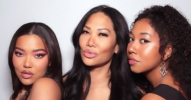 Kimora Lee Simmons' 18-Year-Old Daughter Aoki Looks Gorgeous Posing in a Green Silk Slit Dress