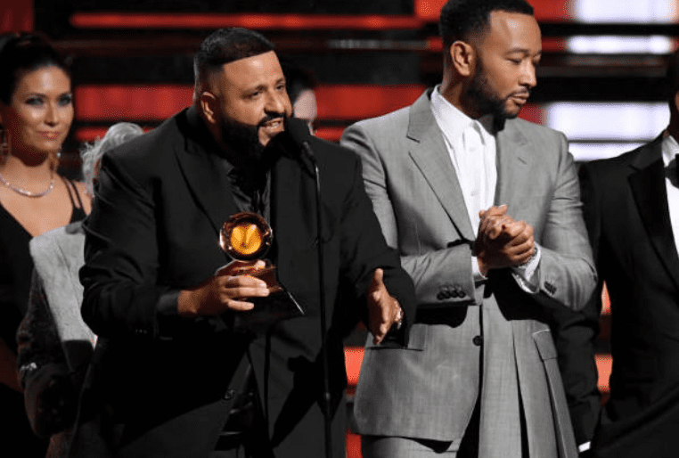 DJ Khaled accepts his first Grammy award while standing next to John Legend for the Best Rap/Sung Performance award for their son 'Higher' at the 62nd Grammy Awards on January 26, 2020, in Los Angeles, California | Source: Getty Images (Photo by Jeff Kravitz/FilmMagic)