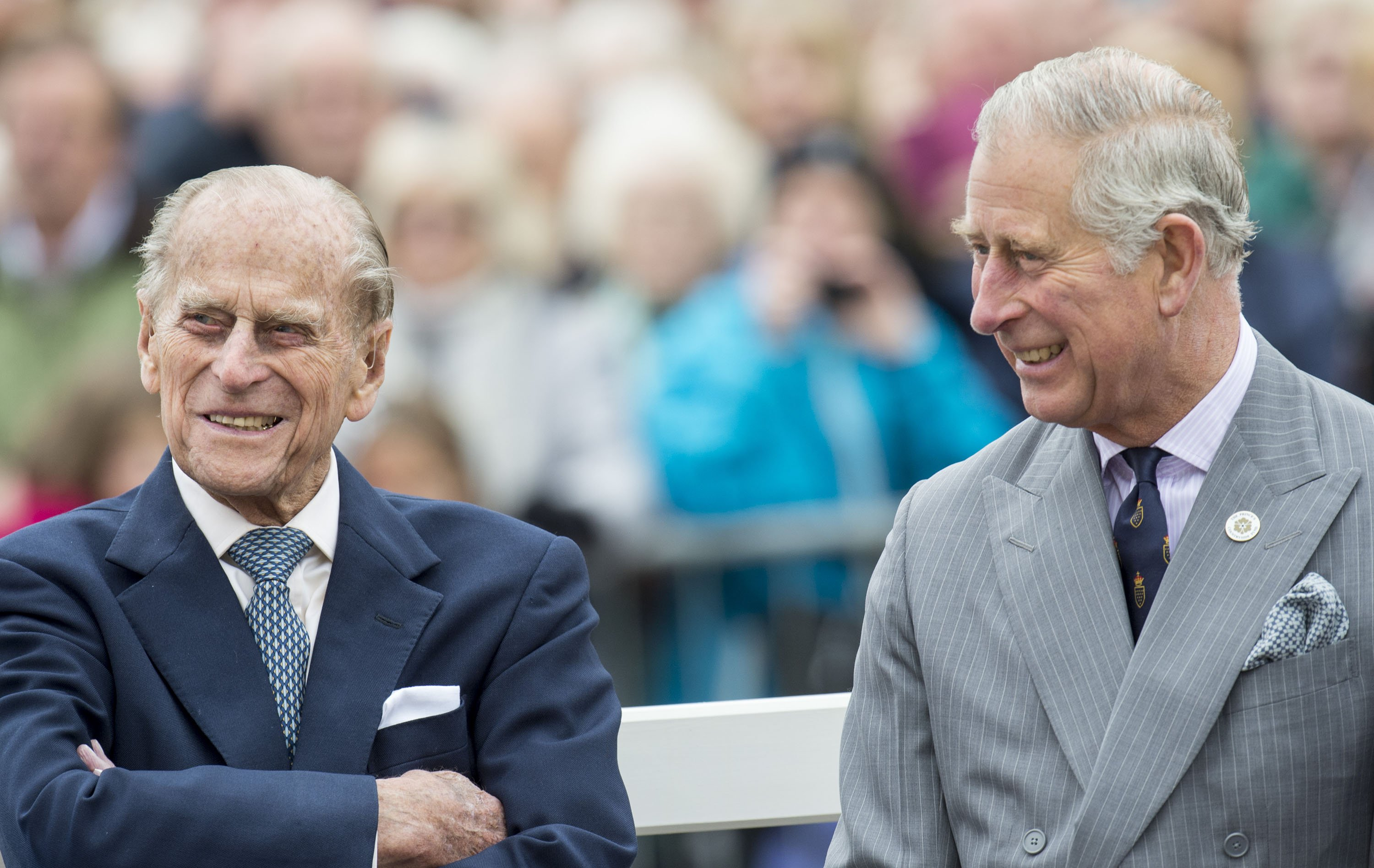 Prince Philip and Prince Charles attend the unveiling of a statue of Queen Elizabeth The Queen Mother during a visit to Poundbury on October 27, 2016 | Photo: Getty Images